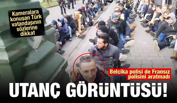 Belçika polisinden göstericilere ters kelepçe