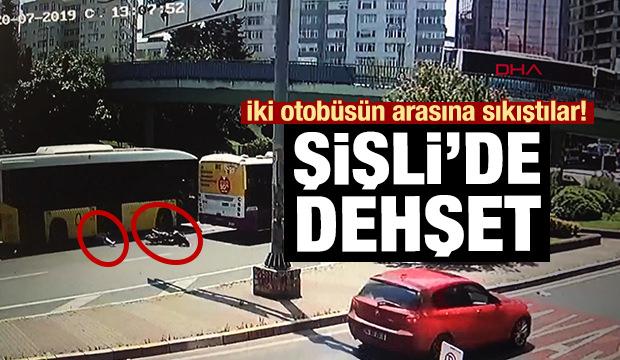 2 otobüsün arasına giren motosikletli metrelerce sürüklendi