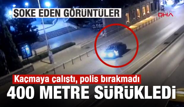 Şoke eden görüntü! Polisi aracın kaputunda sürükledi!