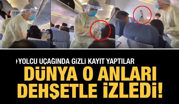 Şaşırtan görüntü! Çin'de uçakta yolculara virüs taraması yapıldı